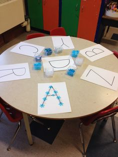 Snow letters with loose parts