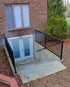 Basement door on pinterest basement entrance basements for Walkout basement windows