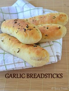 Soft and Delicious Garlic Breadsticks - recipe with step by step pictures via Spicy Treats