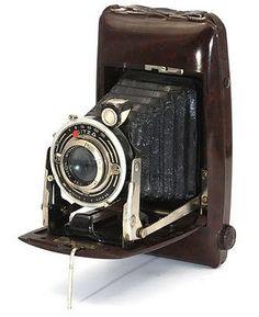 A folding 6 x 9 film camera made by Pontiac, Paris  Bakelite body  1938