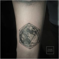 Moon tattoo entrapped in a polygonal prism. By artist Evgeny Kopanov in Prague.