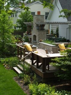backyard idea only smaller. arbor off house to fireplace (outdoor living room) on upper level with steps down to green lover level