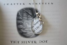 """'Snape & Lily' Patronus Charm Necklace - Snape tattoo, with """"After all this time?"""", """"Always"""" and Lily's Patronus lighting up the darkness behind him."""