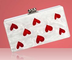 Edie Parker clutch with its modern, smooth look and nod to the highly covetable boxed Lucite bags of the 1950's and 1960's.