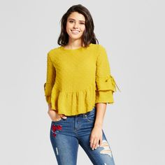Spring into a new season with the sweet style of this Swiss-Dot Double-Ruffle Top from Xhilaration™. The boxy silhouette of this three-quarter-sleeve yellow top keeps you comfortable, while also offering a flattering fit. A delicate Swiss-dot pattern heightens the simple style, while tiered ruffle sleeves and a peplum hem bring a fashion-forward look. Pair with embroidered jeans with a raw hem and your favorite mules or flats for a cute look you can sport throughout the year.