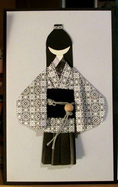 handmade greeting card with an origami folded Japanese doll ... black and white ... like the obi treatment ...