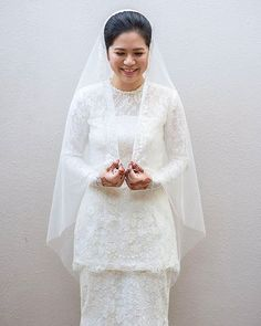 Full french lace Nikah Kurung for her minimal neckline beadings only. Muslimah Wedding Dress, Muslim Wedding Dresses, Designer Wedding Dresses, Wedding Attire, Bridal Dresses, Malay Wedding Dress, Wedding Hijab Styles, Weeding Dress, Beautiful Wedding Gowns