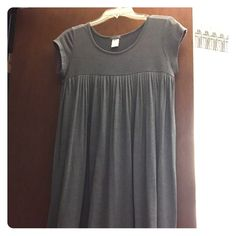 Soft good used condition dress Grey dress lightweight.  Can be worn over leggings or a bathing suit!  Fun dress to twirl.  Some pilling, but no other marks, stains or tears.  I'm 5'6 and it's just above the knees Delias Dresses Midi