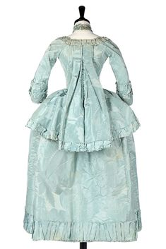 Rear view, pet-en-lair robe, ca. 1770, fabric: late 1730s, early 1740s. Pale turqoise silk damask woven with large-scale flowerheads, fabric trim.