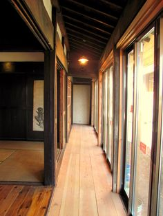 I love these long, narrow hallways with tall windows and wooden floors. Reminds me of my grandmother's house.     Traditional Japanese house. Engawa.