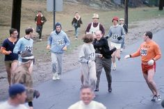 A colour photo of Kathrine Switzer being grabbed by officials in the 1967 Boston Marathon