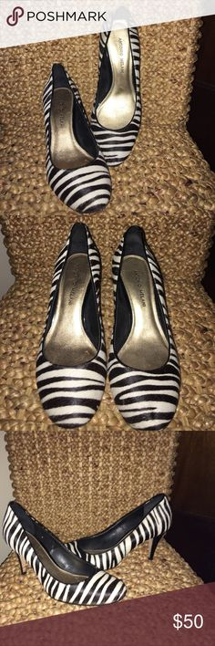 Zibra Print Heals!! These are beautiful Anotonio Melani Black and White Zibra print heals! Super sheik, and elegant. The zebra print is colored fine hair! The shoes are ore-loved, but in excellent condition! Only signs of wear are on inner and bottom soles. Nothing visible when wearing. All proceeds as usual from my closet benefit a local ministry serving women in our community who are rebuilding their lives after domestic violence!!  Save money and bundle!! All fair offers are considered…