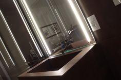 """Mobile bagno rivestito in """"NEOLITH Iron Corten"""" specchio con illuminazione a Led. Tutto progettato e realizzato su misura"""