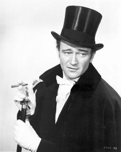 This is the first picture I've ever seen of John Wayne in a top hat. Love it!!!