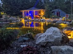 WOW! That's what everybody says when they see this swim pond and pool house lit up at night. Magic happens when the stars are out and the lights illuminate the tranquil waters of this large water feature. Featuring several fountains, waterfalls, bogs, and wildlife this yard is spectacular. Created by Waterpaw Ponds of Michigan your Aquascape water feature experts. Koi Pond Design, Landscape Design, Large Water Features, Pond Maintenance, Boyne City, Traverse City Michigan, Torch Lake, Backyard Paradise, Garden Fountains