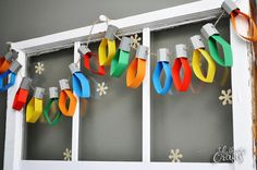 Using Colored Paper And Twine, She Creates A Great Alternative To Traditional Christmas Lights http://www.wimp.com/diy-holiday-lights-from-paper-and-twine/