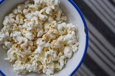 Kettle corn-- 1 cups of freshly popped popcorn tossed around in a bag with half a teaspoon of cinnamon and half a teaspoon of water/half a teaspoon of honey that has been cooked in the microwave for 20 seconds to thin it out.  Only 50 calories for a super satisfying snack