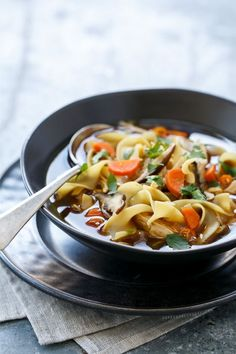 Feeling chilly? This Spicy Asian Chicken Noodle Soup will warm you right up. It's classic comfort food, with a kick!