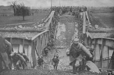 French troops crossing a destroyed bridge over the Canal du Nord