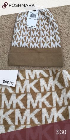 Michael Kors Beanie Camel color with white letters. New with tag and 100% authentic. Soft material. Michael Kors Accessories Hats