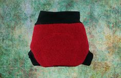 Cherry red european wool diaper cover with knitted merino wool leg and waist bands.