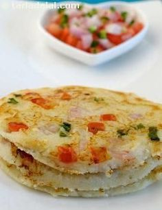 Uttapum was one of my favorite meals to eat in India. In Mumbai it was served with a spicy ketchup or coconut chutney.