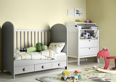 With one side removes, the baby's crib is now a toddler bed.