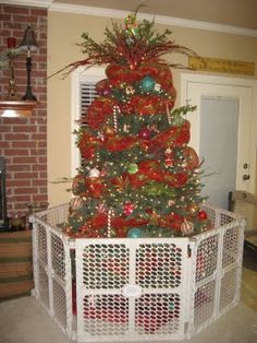 Baby gate around tree? This would be the only way we could put up ...