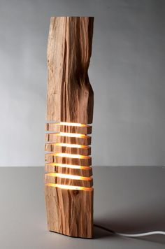 Minimalist Wood Sculpture Fine Art Wood Sculpture on Illuminated Glass Core. $750.00, via Etsy.