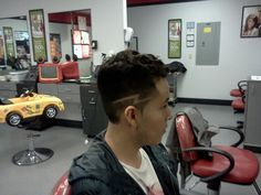High Fade Haircut with Lightning Bolt Design