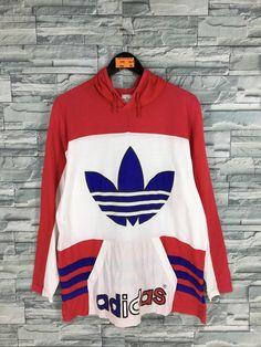 Vintage ADIDAS Trefoil Hoodie Sweatshirt Large Adidas Big Logo Colorblock Hip Hop Streetwear Adidas Run Dmc Pullover Sweater Size L by slayvin on Etsy Run Dmc, Hoodie Sweatshirts, Pullover Sweaters, Hoodies, Stylish Jackets, Cool Jackets, Striped Jeans, Striped Jacket, Hip Hop