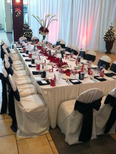 Tuscan Head Table with Pipe & Drape Backdrop & Lighting
