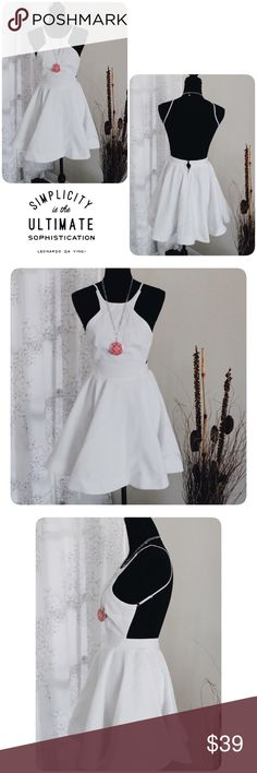L'atiste White Backless Dress NWT Midi length backless dress. Adjustable strap with back hook at the waist. 100% polyester  Measurement might be off couple inch Length 32  Waist 25-26  Bust 32 Length from waist down 18  l'atiste by amy Dresses Mini