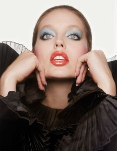 Emily DiDonato gets her closeup in blue eyeshadow and orange lip gloss