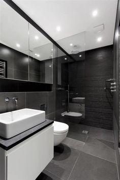 salle-bains-moderne-carrelage-mural-sol-noir-gris-miroirs-modernes-vasque-blanche-meuble-vasque-blanc photos de salle de bains