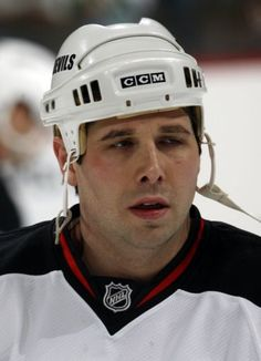 Two people with direct knowledge of the decision have told The Associated Press that former NHL enforcer Andrew Peters has been cleared to resume coaching his youth hockey team in Buffalo following his involvement in an on-ice brawl last month.  A video showed Peters shoving to the ice a player on the