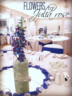 61 best singapore jevel wedding planning images on pinterest blue singapore orchids in a tall cylinder vase in the centre of the guest rtables at a wedding reception a collection of wedding bouquets designed by julia junglespirit Images