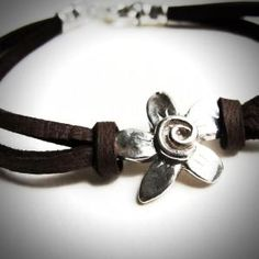 Sterling Spiral Fleur on Leather by rita