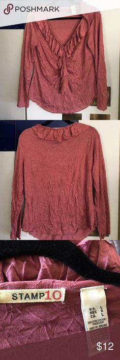 Mauve ruffly Blouse Mauve ruffly shirt and crinkle style. 100% polyester. Size large. Is very stretchy. And very comfortable. Great to rock with boots. Stamp 10 Tops Blouses