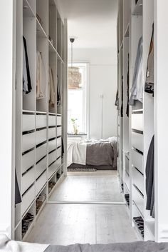 Clothes open storage with IKEA PAX - love how the mirror enlarges this room.