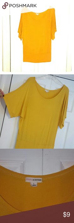 Dolman sleeve top Mustard/ gold colored dolman sleeve shirt. Bamded at waist (small spot on band would probably come out with treating). Very flattering style on. I bought if for football season last year and realized the yellow didnt look good on me with blonde hair. Color is more mustard gold than yellow pictures weren't consistent with color. Zenana Outfitters Tops Blouses
