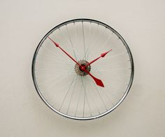 Adorable repurposed bike wheel.
