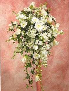 This cascading bridal bouquet design is a has a lovely mixture of old fashioned flowers. Included are sweet pea, lysimachia and stock mixed with a few white mums and accented with ivy.