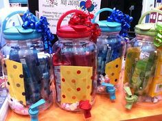 The container is a drink dispenser. Whats inside? Salt water taffy, Goldfish crackers, drink mixes, a coordinating cup, lotion or soap and a card. It doesnt sound like much, but it LOOKS amazing. Great gift idea for teachers, co-workers, etc! nifty-gifties