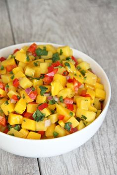 Easy and delicious homemade mango salsa. This is so tasty and versatile, put it on grilled chicken or fish, add to tacos or nachos or add it to salad. YUM!
