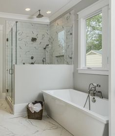 Using the same tile on the floor and on the shower walls, and by just changing their size, helps to create a seamless feel in this space.