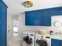 Caribbean blue laundry room cabinets