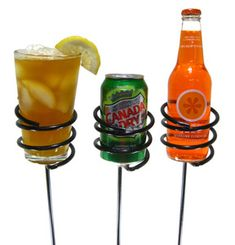 "drink holders for around the firepit.  Love this idea!  I so dislike ""spilled drinks"" during cookouts, or grass/bugs crawling into the drinks from sitting on the ground!"