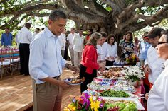 President Barack Obama serves himself during a buffet lunch with President Juan Manuel Santos of Colombia.