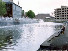 """1970 Colour photograph of a young boy fishing in the Ravenhead branch of the St.Helens (Sankey) Canal close to Pilkington PLC Glass Works and the 'Hotties'.""""The Hotties"""" refers to a series of pipes, located on the south bank of the Sankey Canal, which formerly discharged hot water/steam from the glass works, producing clouds of steam over the canal's surface. STSD/42/1/1/29 (Tray - Pilkingtons somehow seemed to have assumed or bought total control over lots of the canal bank and used it for… Saint Helens, Boy Fishing, The Old Days, My Town, Old Things, Childhood, England, Clouds, Memories"""